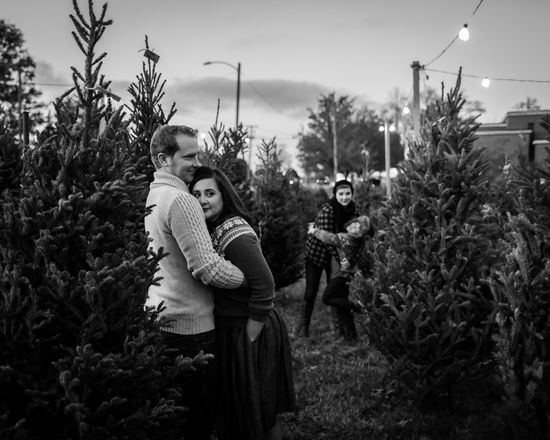 Christmas Adult Bonding Couple - Relationship Emotion Family Females Leisure Activity Lifestyles Love Mid Adult Nature Outdoors Plant Positive Emotion Real People Togetherness Tree Two People Women Young Adult This Is Family