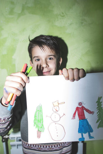 Boy Child Paint Painting Show Shows Winter Wall Home Direct Light Flash Flash Light Shadow Childhood One Person Holding Real People Front View Portrait Creativity Indoors  Looking At Camera Lifestyles Girls Leisure Activity Smiling Casual Clothing Art And Craft Cute Innocence