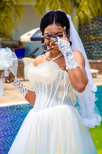 Portrait of bride covering face