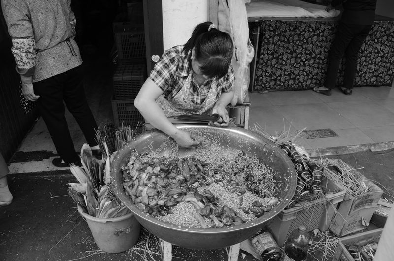 Woman preparing rice in Water Village, Shanghai B&w Street Photography Bamboo Rice Black And White Food Hard Work Local Food People People Photography Preparation  Rice Sitting Street Photography WomeninBusiness Here Belongs To Me Telling Stories Differently Monochrome Photography Women Around The World