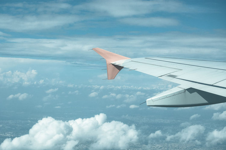 Aerial View Aircraft Wing Beauty In Nature Blue Cloud Cloud - Sky Cloudscape Cloudy Cropped Day Journey Landscape Mid-air Mode Of Transport Mountain Nature No People Outdoors Part Of Scenics Sky Tranquil Scene Tranquility Weather White