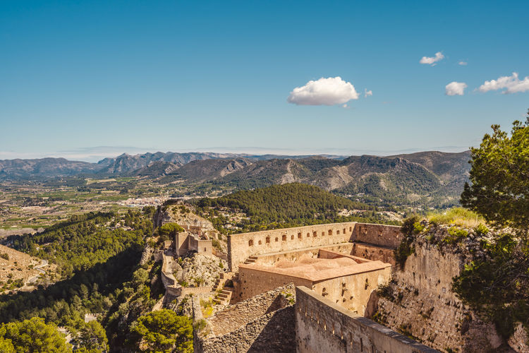 Scenic view from the Xativa fortress. View to the mountains and skyes. Medieval construction, castle. Architecture Sky Mountain Built Structure Scenics - Nature Travel Destinations Nature Cloud - Sky Tree Building Exterior History Day No People The Past Landscape Mountain Range High Angle View Beauty In Nature Plant Environment Outdoors Ancient Civilization Archaeology Xativa Castle Medieval Architecture Medieval Mediterranean  SPAIN Mountains Clear Skies Travel Destination Touristic