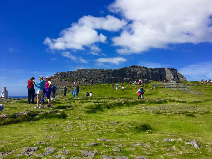 Sky Nature Grass Cloud - Sky Real People Landscape Field Day Green Color Leisure Activity Blue Men Beauty In Nature Lifestyles Outdoors Scenics Large Group Of People Women Adventure Circle Fort Inishmore Aran Islands Ireland