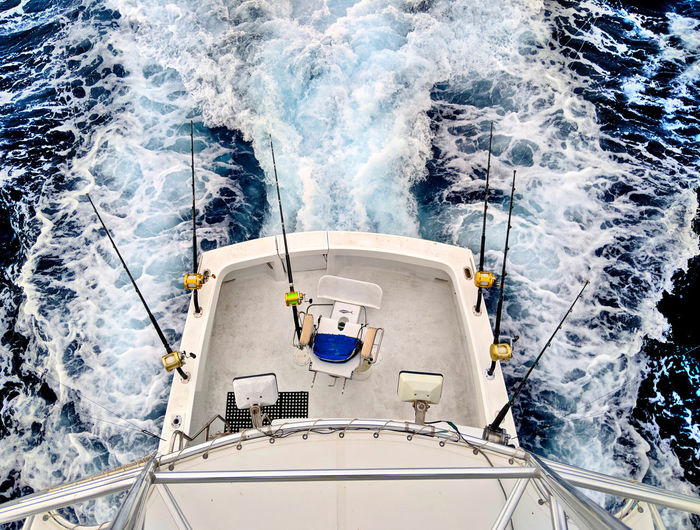 Blue Ocean Cerulean Blue Perspective Perspectives on Nature Boat Boat Captain Cerulean Fishing Fishing Boat High Angle View Nautical Vessel No People Ocean On The Open Sea Open Ocean Sea Ship Sport Sport Fishing Transportation View From Above Wake - Water Water Yacht