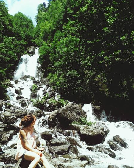 Water One Person Day Nature Real People Outdoors Young Women Relaxation People Only Women One Woman Only Beauty In Nature Waterfall Flowing Water Let's Go. Together. Gagra Plant Summer Beauty In Nature