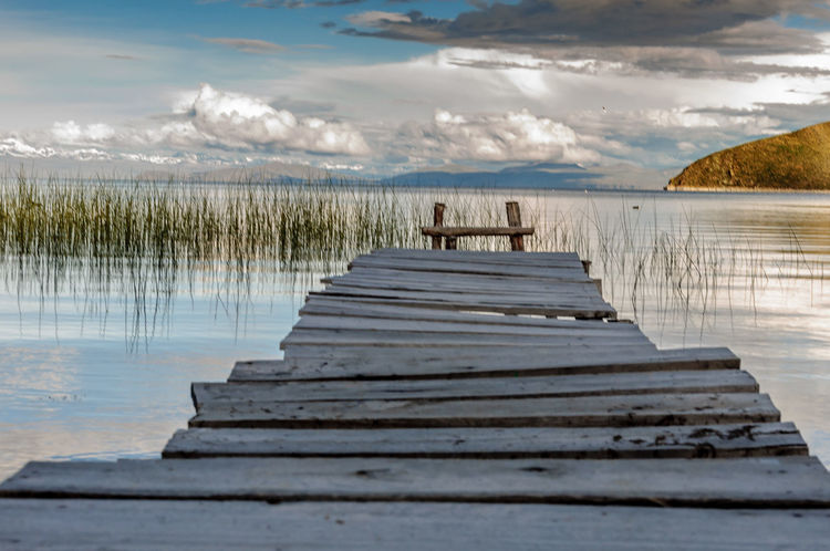 """""""Uneven Path for a certain future"""" Andes High Perspective Perspectives On Nature Punto De Fuga Titicaca Titicaca Lake Totora Beauty In Nature Cloud - Sky Day Lake Nature No People Outdoors Reflection Scenics Sky Tranquil Scene Tranquility Vanishing Point Water"""