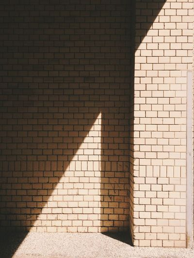 Sunlight On Brick Wall