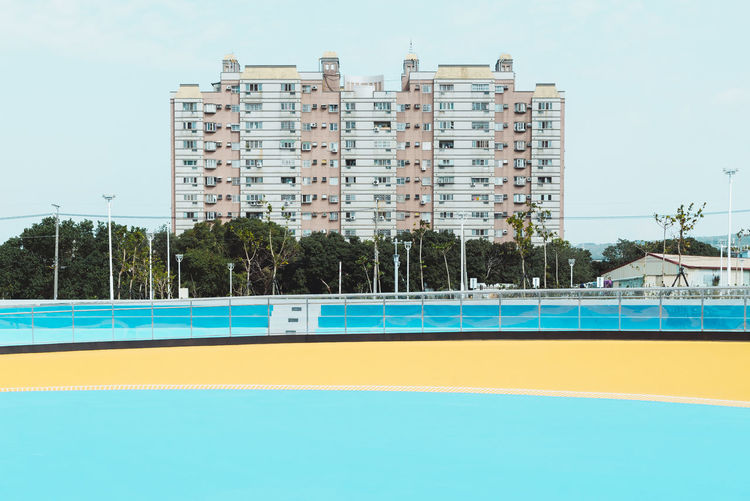 Photo from Taiwan-Trip 2017 Pastel Power The Architect - 2018 EyeEm Awards Sports Field Apartment Architecture Blue Building Building Exterior Built Structure Pastel Pastel Colored Pastel Colors Residential District Running Track Sport Window Sports Field Apartment Architecture Blue Building Building Exterior Built Structure Pastel Pastel Colored Pastel Colors Residential District Running Track Sport Window