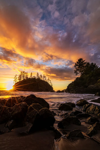 Sunset at Trinidad State Beach, California. Sky Sunset Cloud - Sky Beauty In Nature Rock Scenics - Nature Rock - Object Water Solid Tranquility Tranquil Scene Sea Land Beach Nature Orange Color Rock Formation No People Idyllic Outdoors Eroded Sun Surf Sunstar Star Landscape Seascape