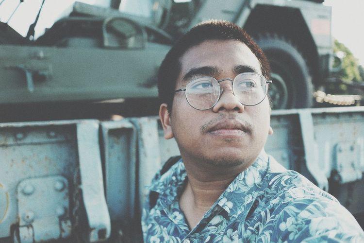 Man wearing eyeglasses looking away