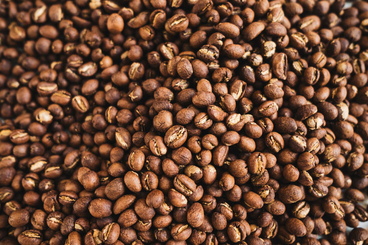Premium roasted coffee beans on background