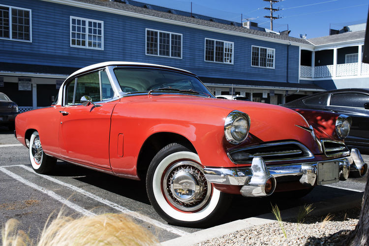 A classic vintage collector's car in a parking lot in Santa Monica, California Car Chrome City Day Garage Land Vehicle Luxury Mode Of Transportation Motor Vehicle No People Outdoors Red Retro Styled Sports Car Stationary Street Transportation Vintage Car Wheel