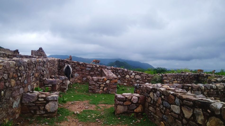 Haunted Place Bhangarh Fort Jaipur India Bhangarh Fort Bhangarhfort Ghosts Scenics Haunted Palace Ghostly Haunted Places Haunted Forts Jaipur Rajasthan Bhangarh Haunted Jaipur Cloud - Sky No People Outdoors Ancient Mountain Day Travel Destinations Colour Your Horizn Going Remote