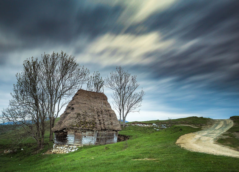 Ancient Apuseni Architecture Beauty In Nature Building Exterior Built Structure Cloud - Sky Grass History Long Exposure Nature No People Old Buildings Old House Old Ruin Outdoors Road Romania The Past Traditional Tranquility Tree