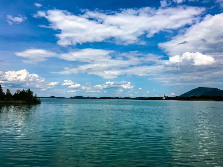 Bavaria Forrgensee Beauty In Nature Blue Cloud - Sky Day Eye4photography  Forggensee Germany Lake Mountain Nature Nature_collection No People Outdoors Rippled Scenics Skx Sky Tranquil Scene Tranquility Tree View Into Land Water Waterfront
