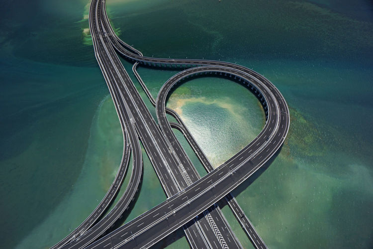 Aerial view of highway over sea