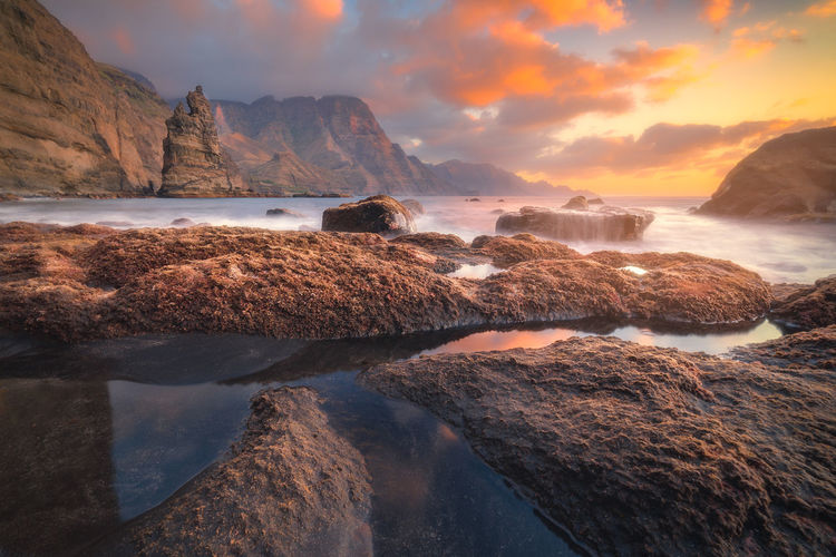 Cute Agaete Sunset Mountain Cliff Water Beach Cloud - Sky Landscape Sky Scenics - Nature Sea Nature Rock Solid Tranquility Motion Outdoors Flowing Water