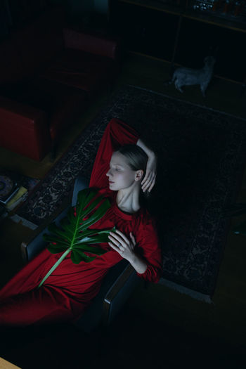 The Week on EyeEm Woman Who Inspire You Still Life Cinematic Red Green Portrait Of A Woman Sadness Solitude Loneliness Indoors  Lifestyles Young Adult Eyes Closed  Lying Down Portrait