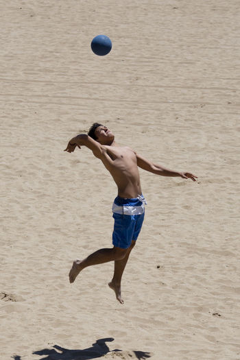 Young mean playing Beach Volleyball Adult Barcelona Beach Beach Life Beach Photography Beach Volleyball Competition Exercising Full Length Healthy Lifestyle In Air Men Motion One Man Only One Person Only Men People Playing Practicing Shirtless Skill  Sport Sports Clothing Sports Training Volleyball Live For The Story