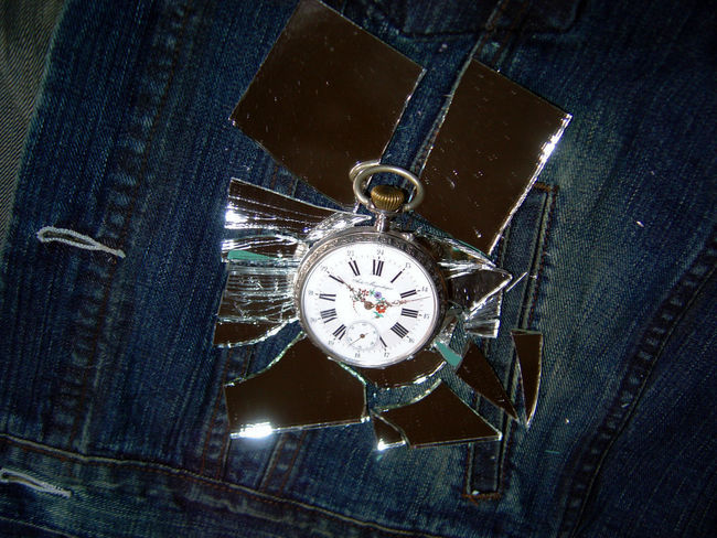 Broken mirror, time is running away Broken Glass Drama Jeans Mirror Past Bluejeans Broken Broken Mirror Clock Clock Face Close-up Day Denim Denim Jacket Fatality Hurt Indoors  No People Old-fashioned Pocket Watch Roman Numeral Symbolic  Time Timeflies Watch