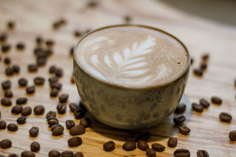 Coffee Coffee - Drink Coffee Cup Coffee Time Coffee Break Food And Drink Indoors  No People Drink Refreshment Cup Cappuccino Still Life Mug Close-up Roasted Coffee Bean Frothy Drink Food Hot Drink Wood - Material Focus On Foreground Latte Caffeine Non-alcoholic Beverage Crockery