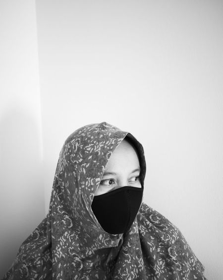 Woman wearing mask at home