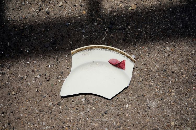 Broken Piece Broken Plate Sand High Angle View Land Beach No People Day Nature Sunlight Close-up Still Life White Color Outdoors Road Abandoned Single Object Damaged Asphalt White City