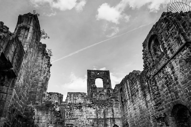 Low angle view of kirkstall abbey against sky