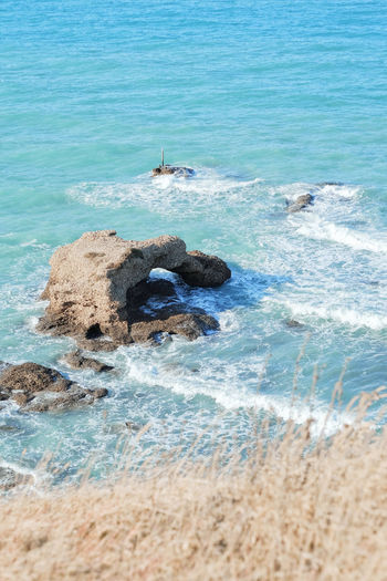 Water Sea Land Beach Motion Beauty In Nature Day Nature Scenics - Nature Rock Blue Wave No People Tranquility Outdoors High Angle View Rock - Object