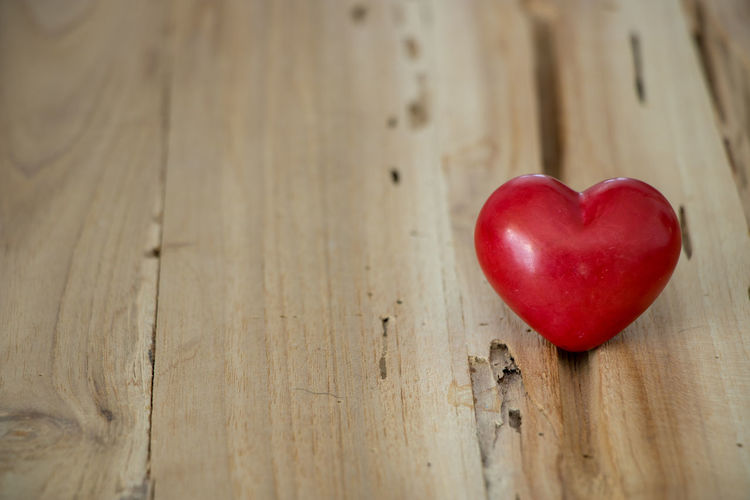 Close-up of red heart shape on table