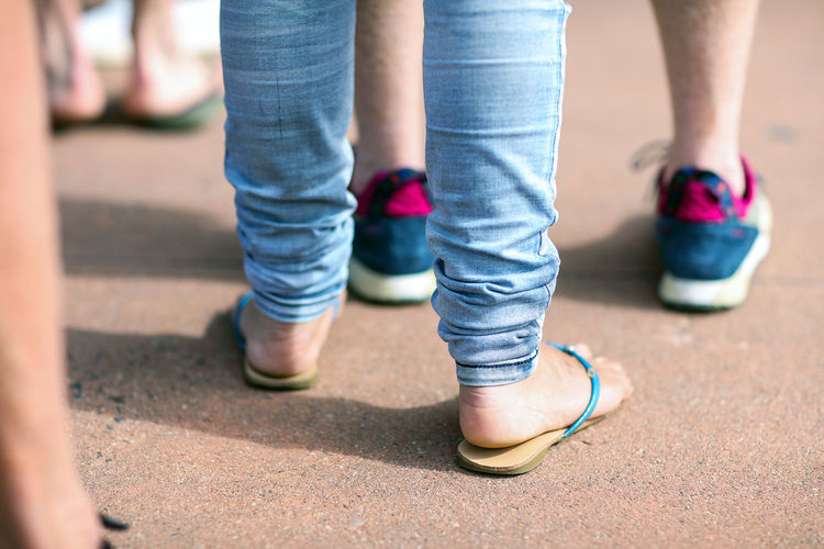 The queue Casual Clothing Feet Flip Flops Human Foot Legs LINE Outdoors Part Of Queue Selective Focus Standing Standing In A Queue Standing In Line Trainers Waiting