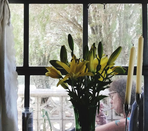 MYM having her cig Flower Window Flower Head Indoors  Fragility Vase Day Home Interior Nature Petal Yellow Beauty In Nature Freshness Plant Growth Close-up Easter vero beach Florida The Portraitist - 2017 EyeEm Awards
