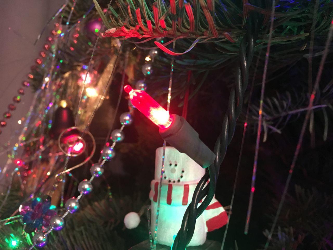 Close-Up Of Illuminated Christmas Lights On Tree