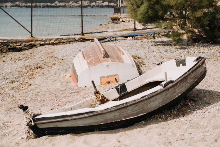 High angle view of abandoned boat moored on beach