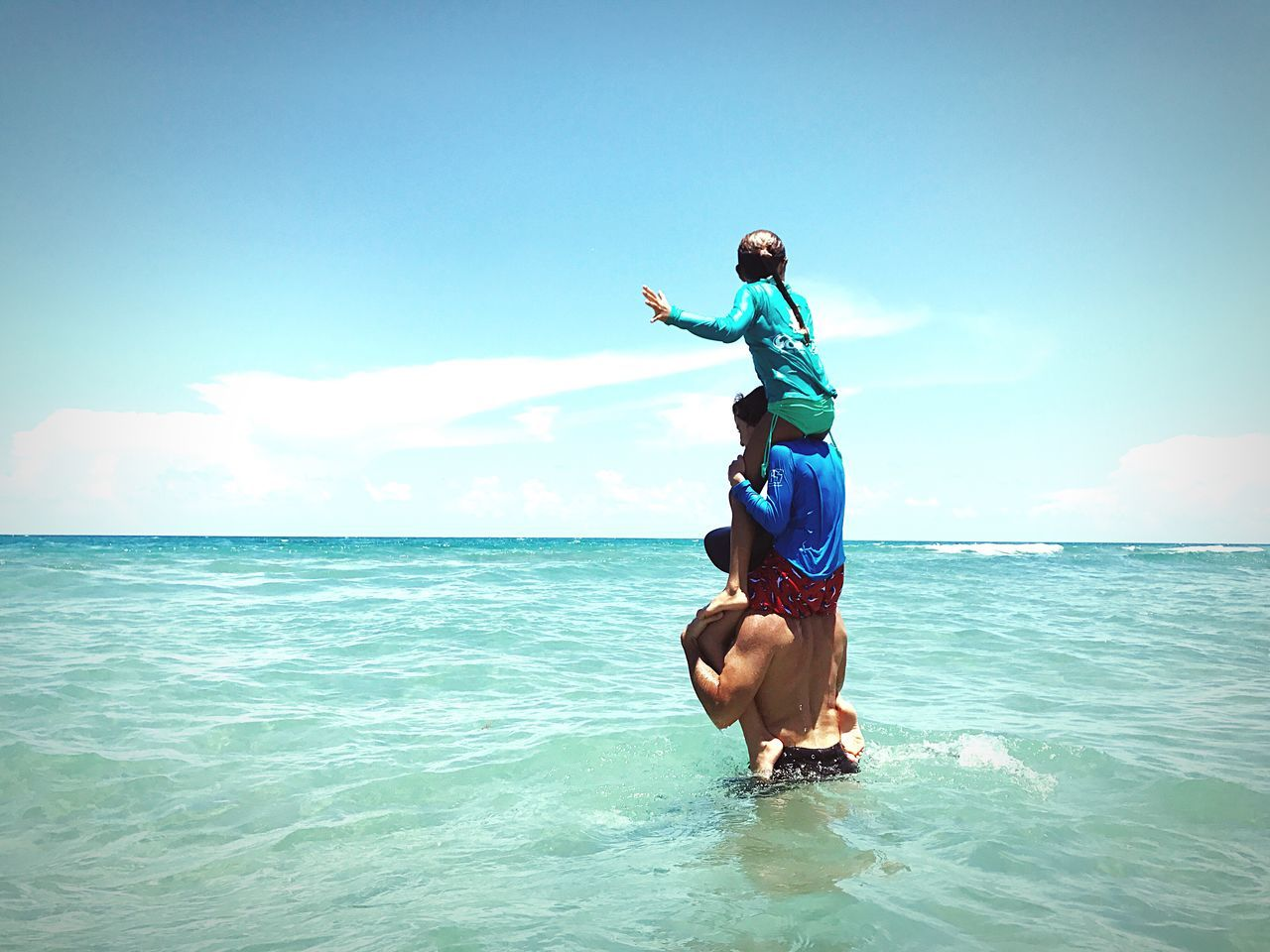 sea, sky, horizon over water, real people, nature, water, full length, mid adult men, beauty in nature, rear view, day, mid adult, leisure activity, outdoors, lifestyles, cloud - sky, scenics, blue, one person, beach, men, vacations, people
