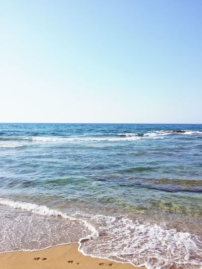Footprints in the Sand of CreteBeach Sand Horizon Over Water Vacations Water Travel Destinations Tranquility Scenics Summer Blue Tourism No People Clear Sky Day Sea Footprints Turquoise Waves Nature Outdoors Sunny Matala Crete Greek Greece
