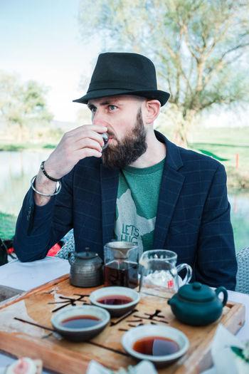 Man drinking tea ceremony on table