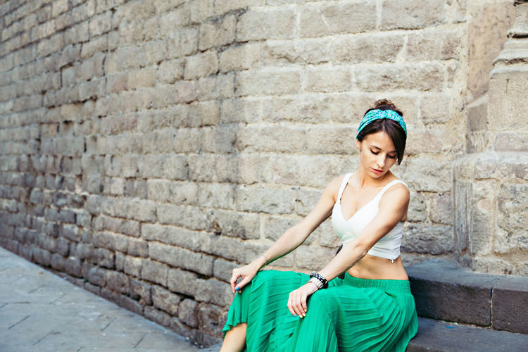 Adult Adults Only Beautiful People Beautiful Woman Beauty Brick Wall Built Structure City Day Fashion Fashion Model Happiness One Person One Woman Only One Young Woman Only Only Women Outdoors People Portrait Sleeveless Top Smiling Standing Young Adult Young Women