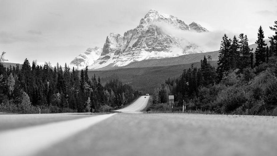 Extreme low angle, shows the interesting blurred curves of the road in the bottom against the awe inspiring heights of the snow covered Mount Robson in mighty Black and White, British Columbia,Canada. Nature Sky Landscape Tree Snow Day Road Outdoors Tranquility Transportation Mountain Plant Environment Beauty In Nature No People Tranquil Scene Mountain Range Non-urban Scene Cloud - Sky Surface Level Snowcapped Mountain Mount Robson, Canada Mount Robson Mount Robson Provincial Park Scenics - Nature 17.62° My Best Photo The Minimalist - 2019 EyeEm Awards
