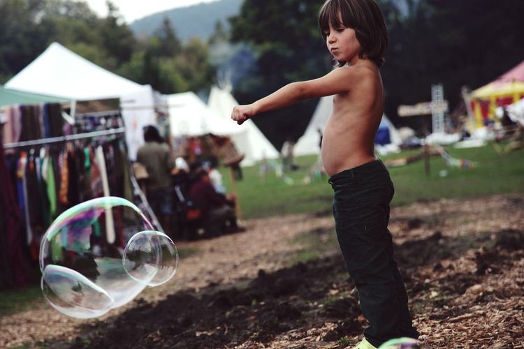 Child One Boy Only People Childhood Playing Outdoors Summer Real People Shirtless Human Body Part Nature Day Bubble Bubbles Soap Bubble Soap Bubbles Fist EyeEmNewHere The Portraitist - 2017 EyeEm Awards Live For The Story Sommergefühle Be. Ready. A New Beginning