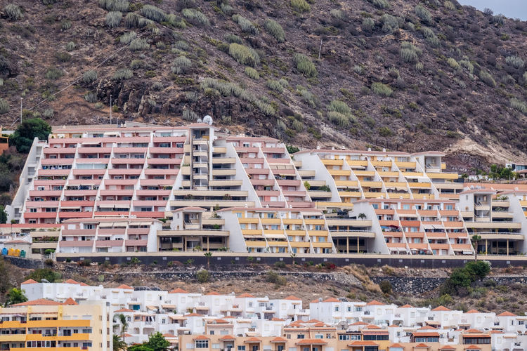 Aerial view at hillside full of vacation homes close together at canary island