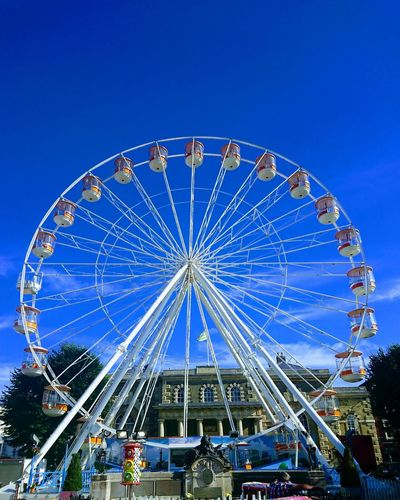 Amusement Park Arts Culture And Entertainment Amusement Park Ride Ferris Wheel Blue Carousel Circle Clear Sky Traveling Carnival Sky No People Low Angle View Merry-go-round Day Outdoors Leisure Activity Illuminated Ferriswheel Summertime Salisburyeye Saliburymarket