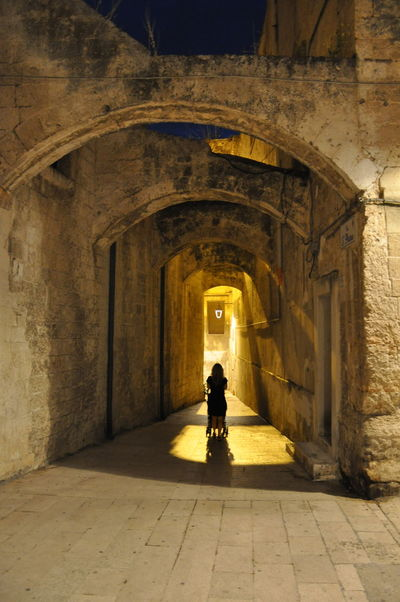 Arch Architecture Architecture Archway Built Structure History Italy Lifestyles Light Light And Shadow Medieval Mother Mother And Child Night Outdoors Puglia The City Light The City Lights Tunnel The Great Outdoors - 2017 EyeEm Awards An Eye For Travel