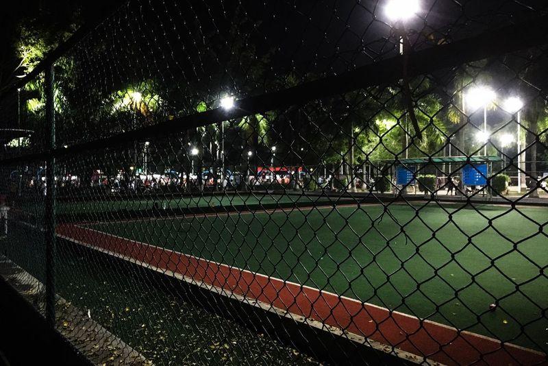 Sport Illuminated Lighting Equipment Green Color No People Fence