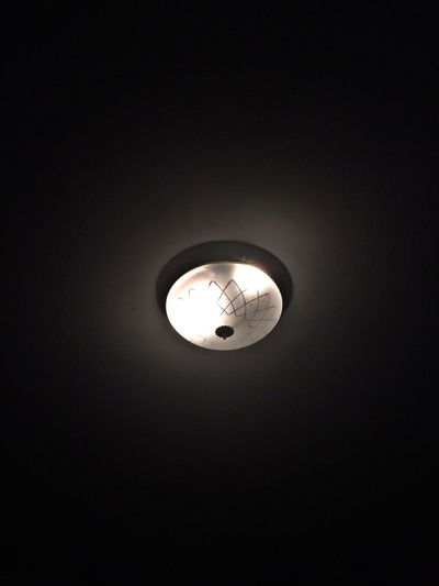 Low angle view of illuminated lamp