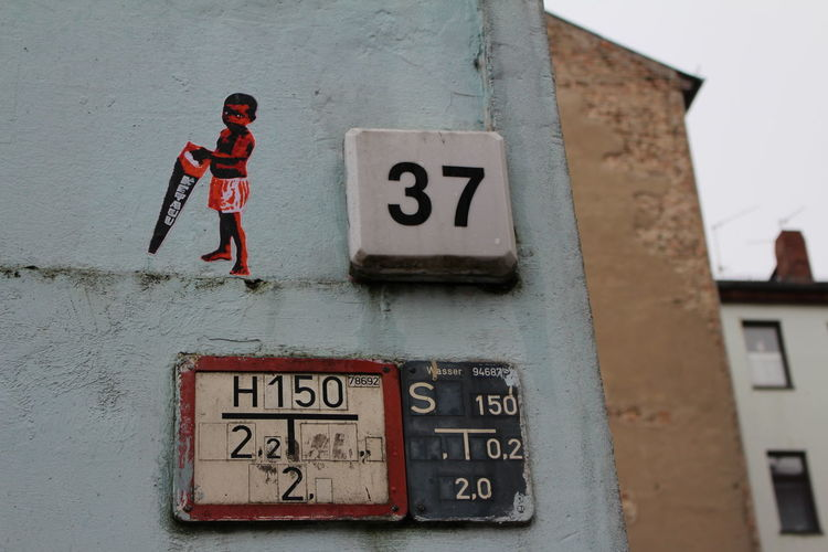 Low angle view of photograph and number on wall