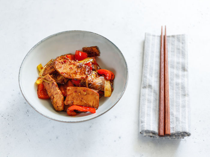 Szechuan Dish ASIA Asian  Food Pork Fried Cooked Vegetables Spicy Chili. Hot White Recipe Portion One Dinner person Sticks Top Above View Plate Bowl Pieces Soy Sauce Fry Wok Chinese Roasted Pan Meat Pepper Bell Leek Onion Food And Drink Table Still Life Freshness Indoors  Ready-to-eat Directly Above High Angle View Healthy Eating Wellbeing No People Serving Size Chicken Eating Utensil White Background Kitchen Utensil Chicken Meat Table Knife Tray