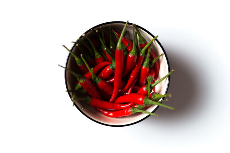 Red hot chillies in a bowl isolated over white background Background Backgrounds Chili  Chilli Close-up Cooking Diet Eat Food Freshness Growth Indian Ingredient Isolated Mexican Natural Nature Nutrition Nutritious Pepper Raw Spice Spicy Vegetable