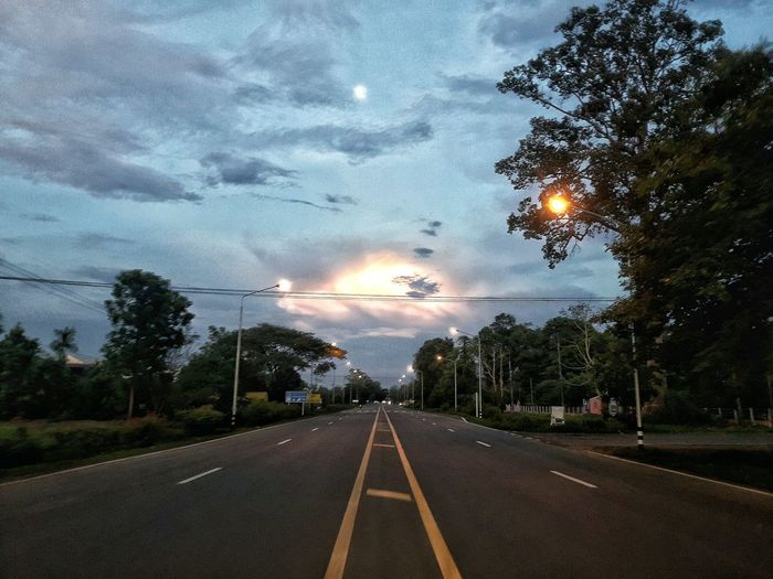 The Way Forward Tree Sky Road Marking Road Transportation Diminishing Perspective No People Illuminated Cloud - Sky Dusk Outdoors Nature Sunset Day Water