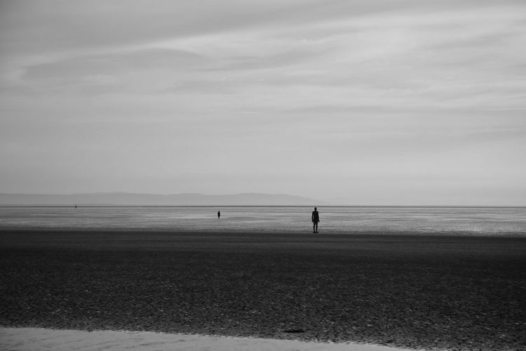 Crosby Beach Sky Scenics - Nature Water Beauty In Nature Sea Nature Crosby Beach Land Beach Cloud - Sky Tranquil Scene Horizon Horizon Over Water Real People Tranquility Day Unrecognizable Person One Person Non-urban Scene Lifestyles Outdoors